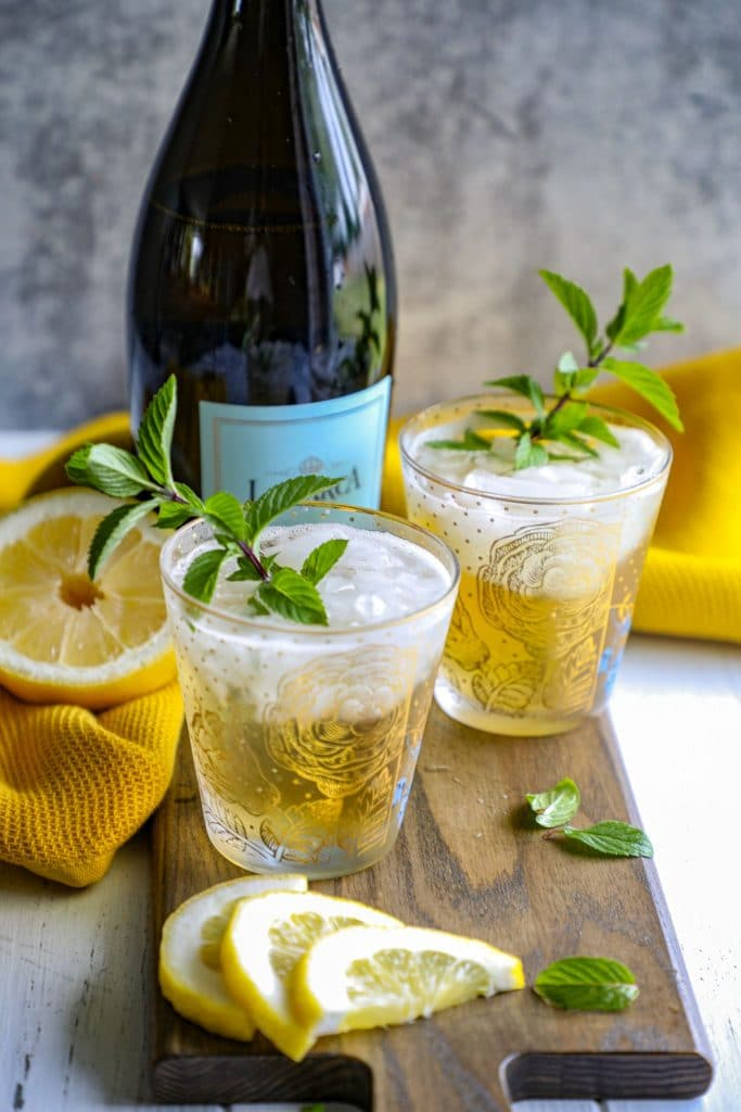 two glasses of prosecco mint juleps
