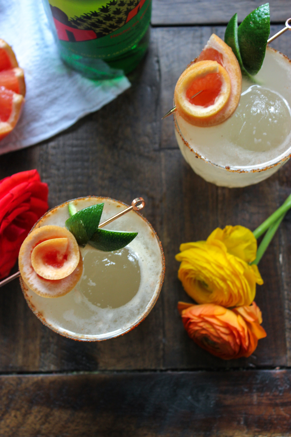 Put down the margarita and pick up this refreshing, mezcal paloma instead! It's bright, a little smoky, and something your next taco night needs!