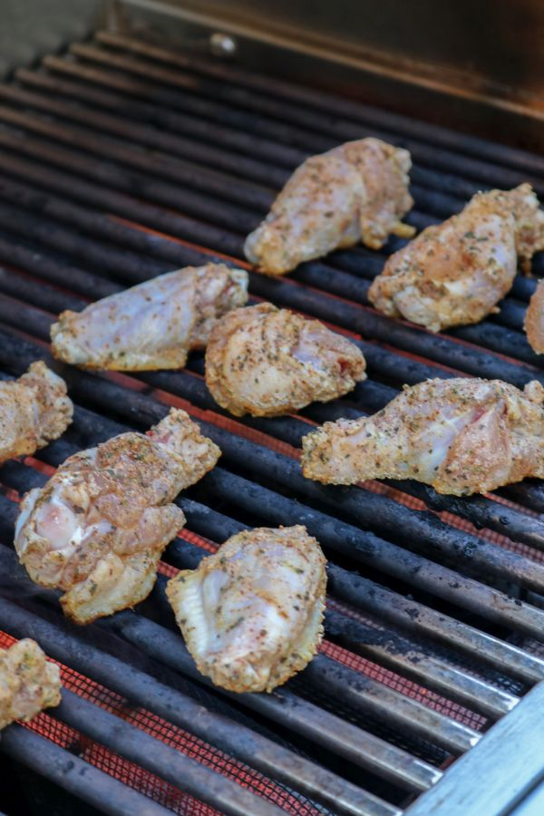 Thai curry chicken wings being grilled