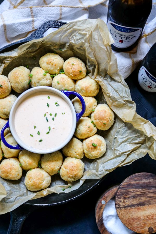 keto cheddar biscuit bombs with cheese sauce and beer