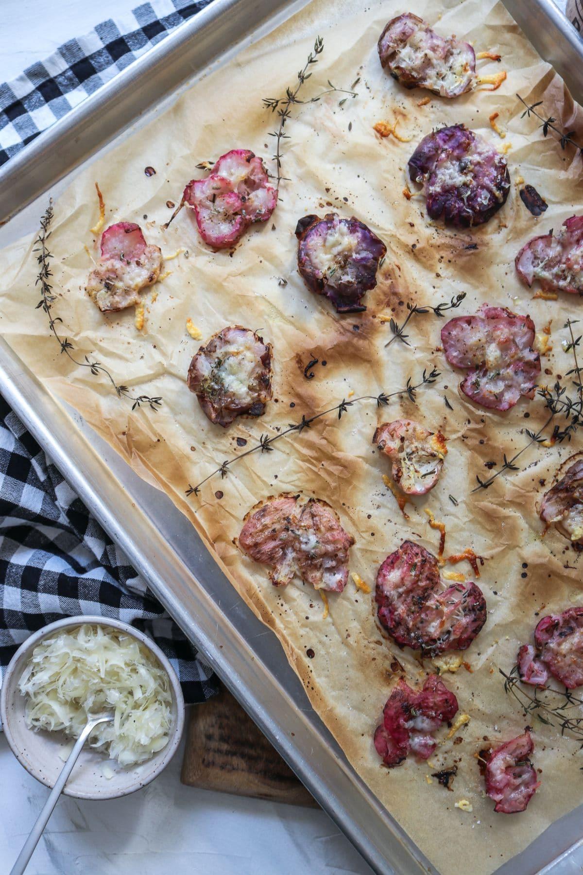 oven roasted radishes on a baking sheet