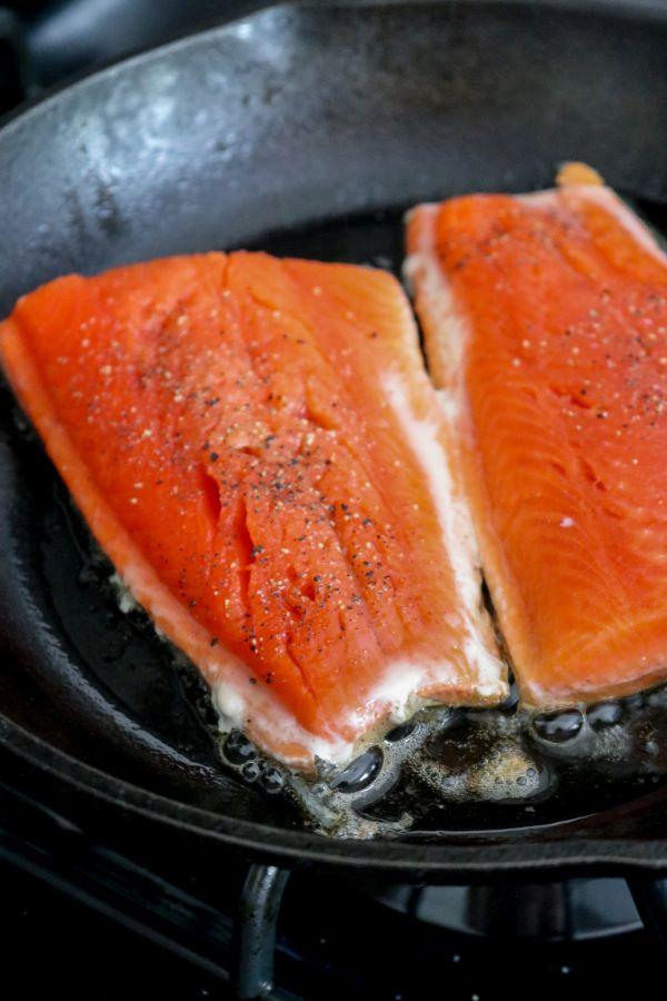 Cast iron pan searing salmon skin