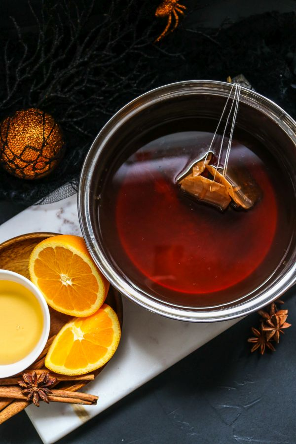 brewed chai tea with cinnamon and oranges