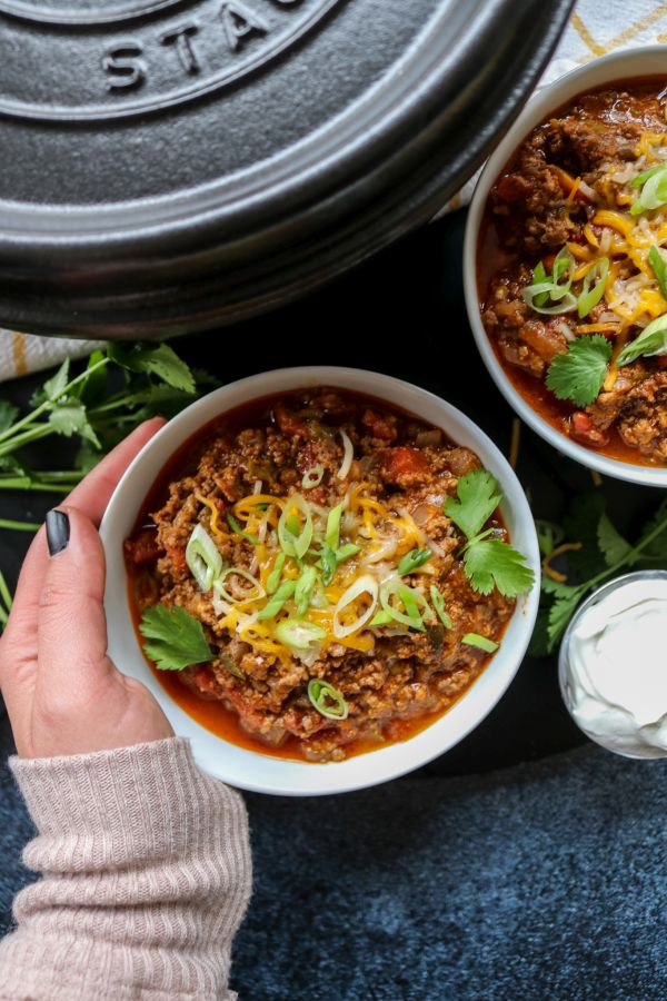 Hand holding low carb beef chili