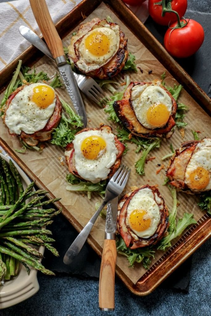 Six open faced keto croque madame on a tray.