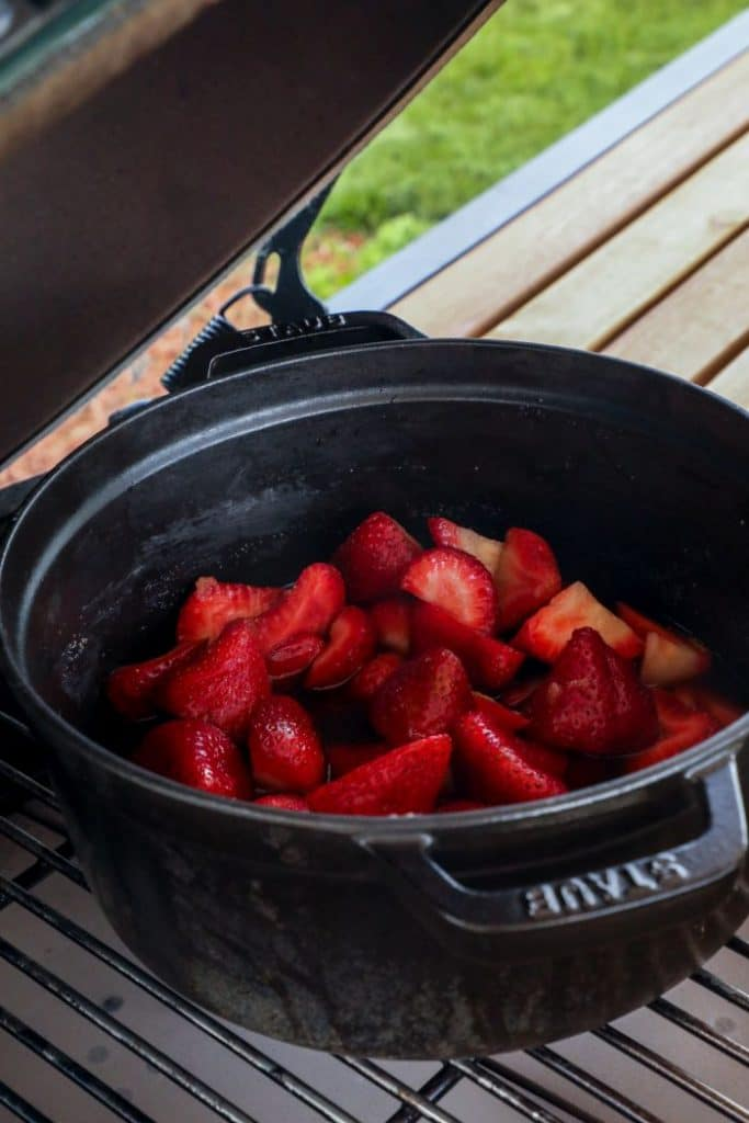 This simple and versatile homemade strawberry sauce on the grill, takes a classic delicious topping, over the top! By combining the classic sweet and tangy fresh strawberries with classic smoke flavors you can create a unique recipe for desserts and savory dishes alike.