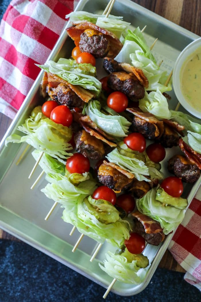 Close up of burger kebabs on a tray.