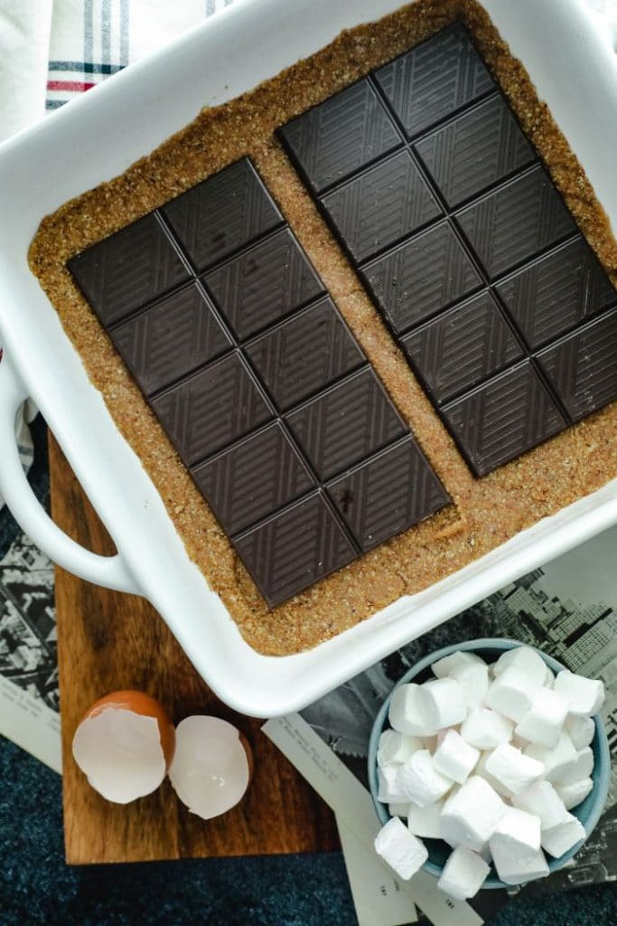 Chocolate bars placed over the baked crust