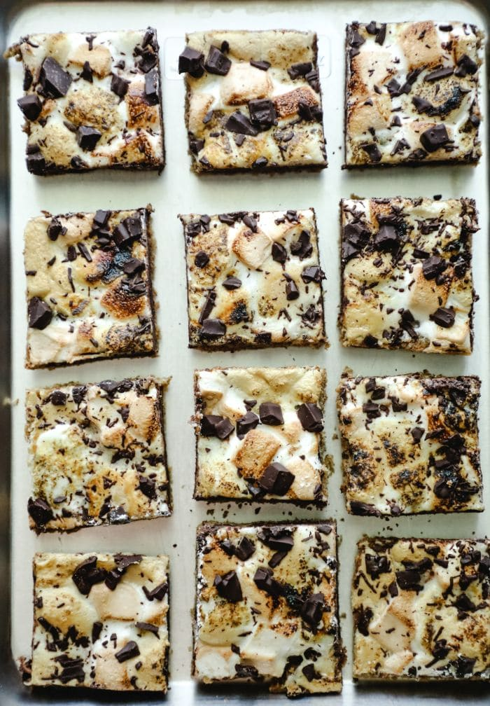 12 smores bars in rows on a baking sheet