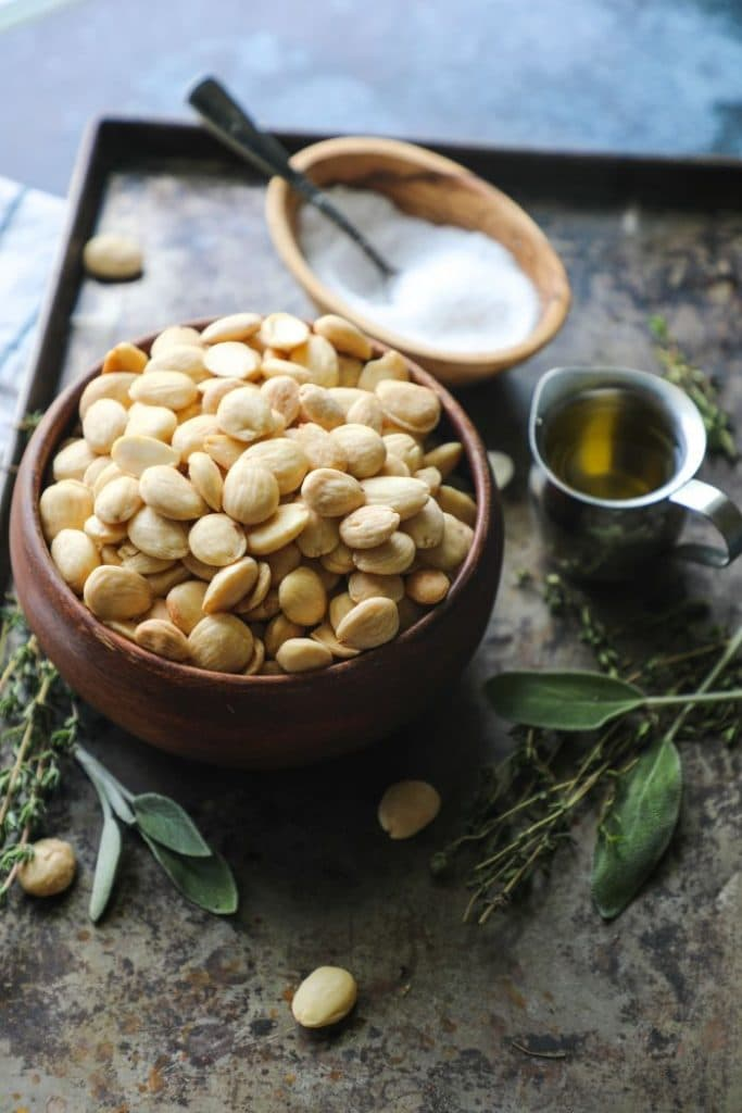 Raw Marcona Almonds in a brown bowl.