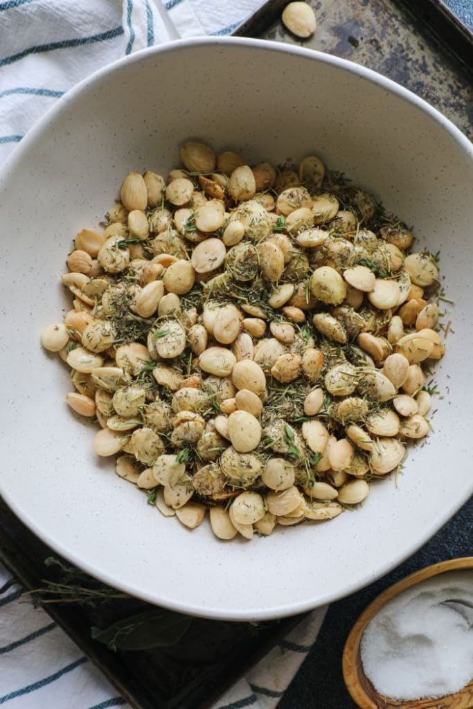 A mixing bowl with the nuts, herbs, and egg white mixture.