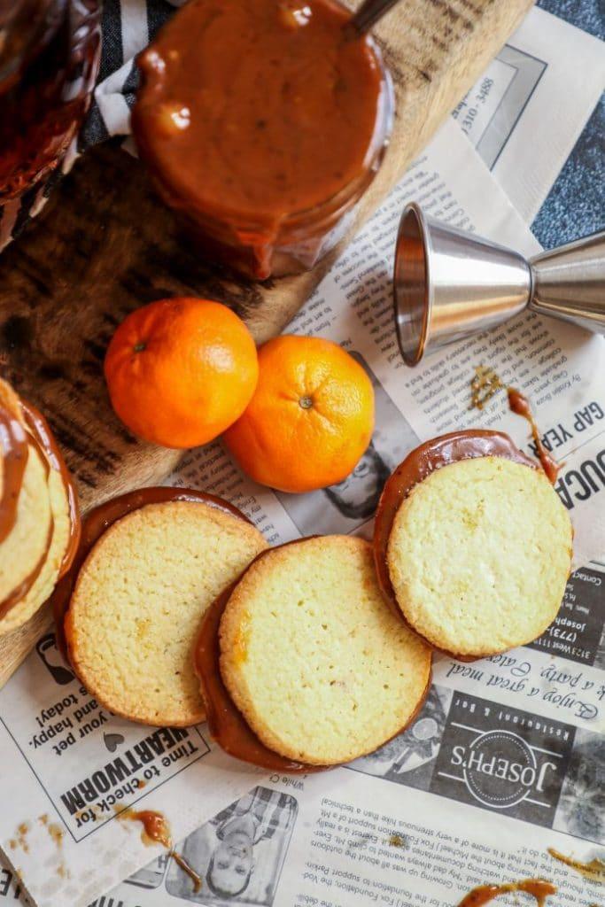 Keto Alfajores cookies on newspaper