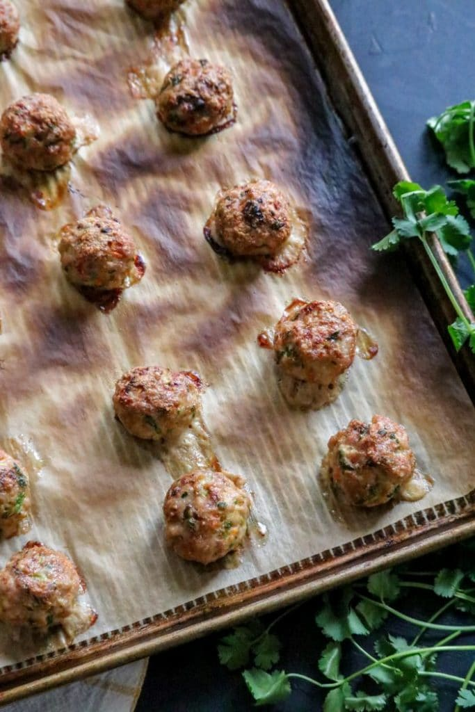 Baked egg roll meatballs on a sheet pan.