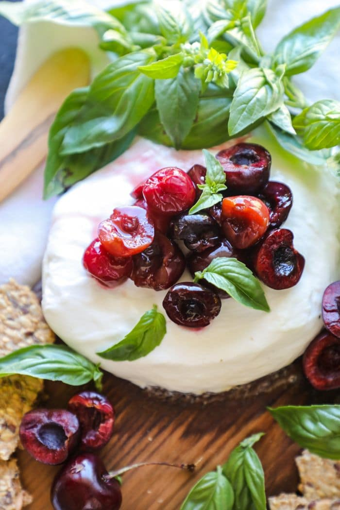 Cedar Plank Smoked Burrata with cherries and basil