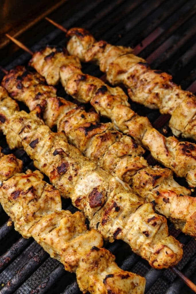 Chicken kebabs on the grill on direct heat.