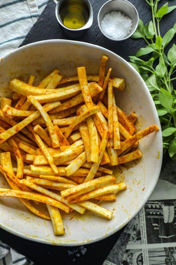 Seasoned keto jicama fries in a white bowl.