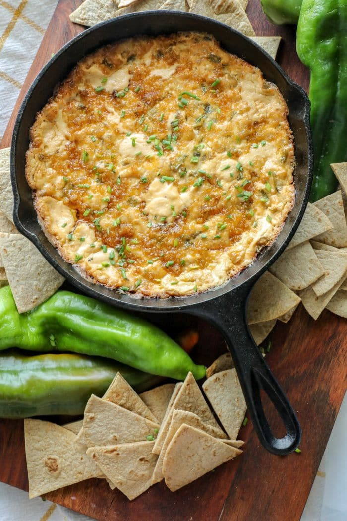 Smoked Hatch Chili Pepper Dip in a cast iron pan with keto tortilla chips