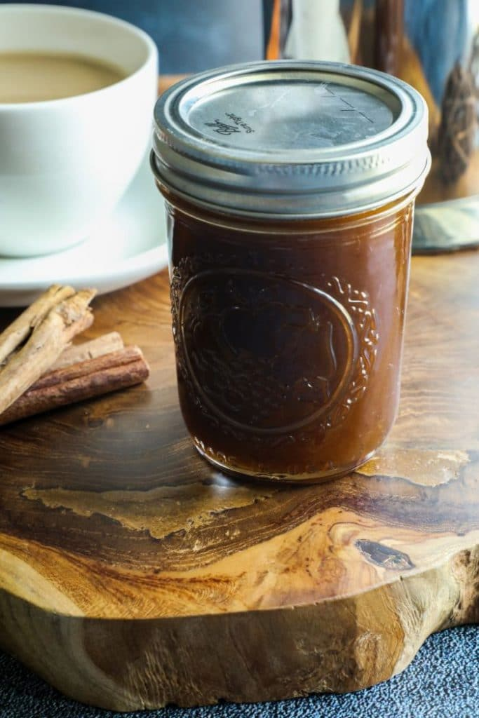A jar filled with Keto Pumpkin Spice Simple Syrup