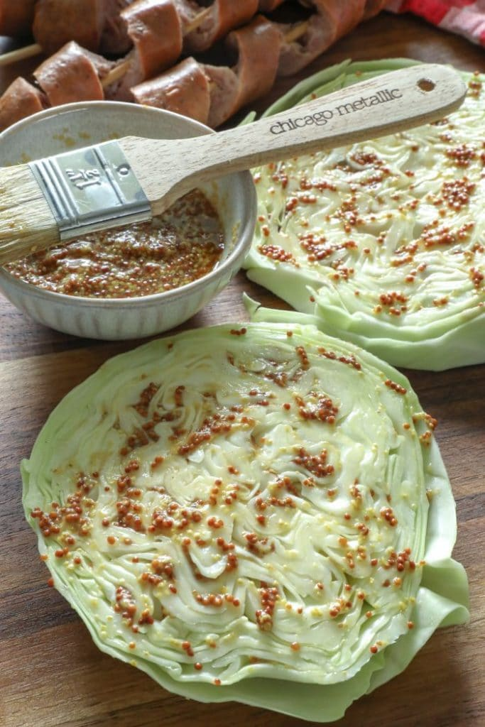 Mustard marinade over the cabbage steaks.