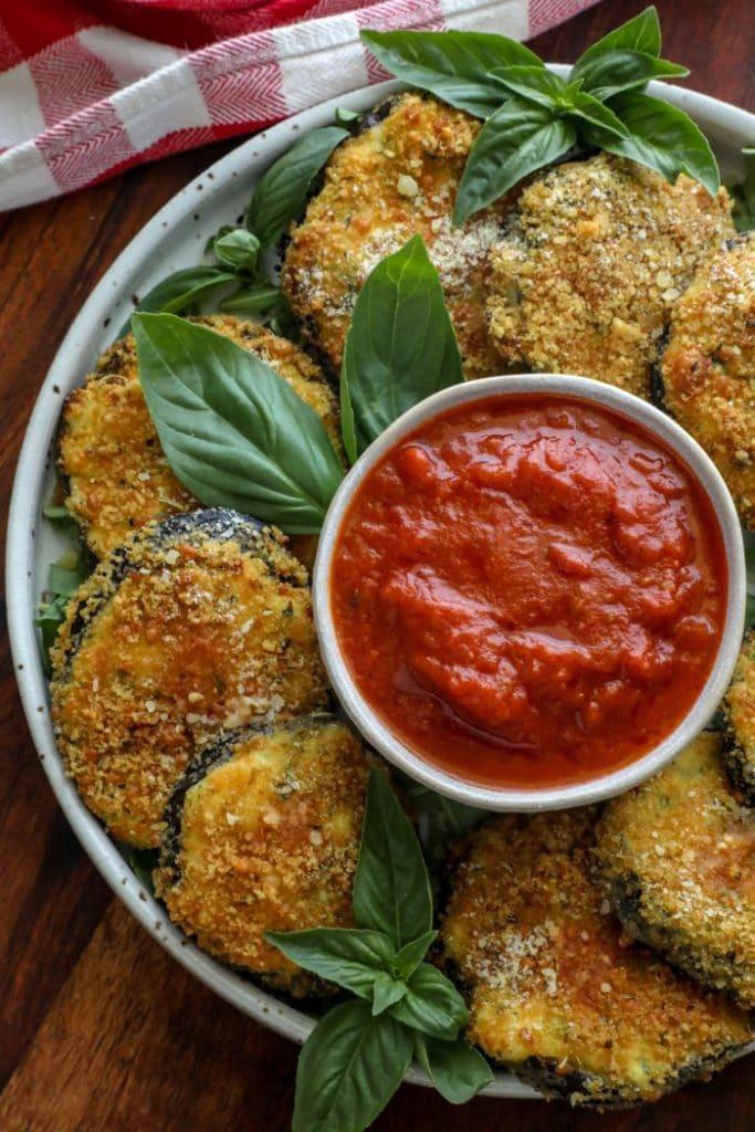 A plate of Crispy Keto Ricotta Stuffed Eggplant Rounds
