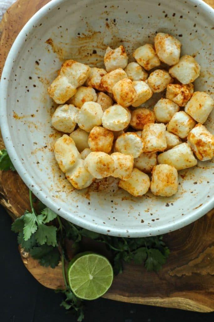 A bowl of seasoned cauliflower gnocchi