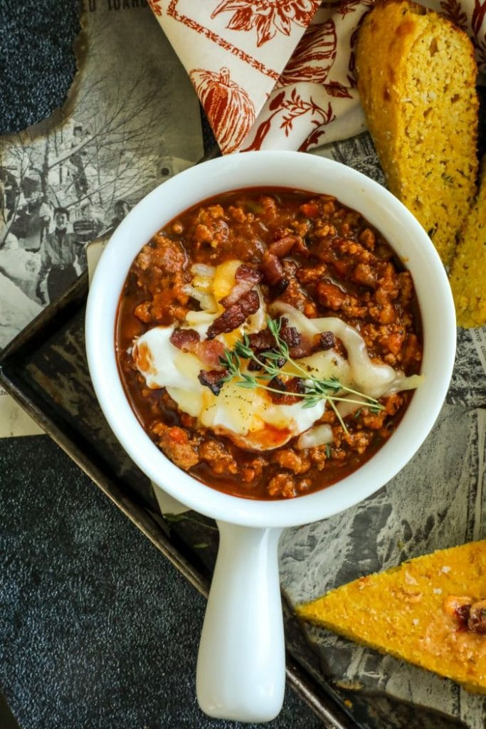 One white bowl filled with Low Carb Chipotle Pumpkin Turkey Chili