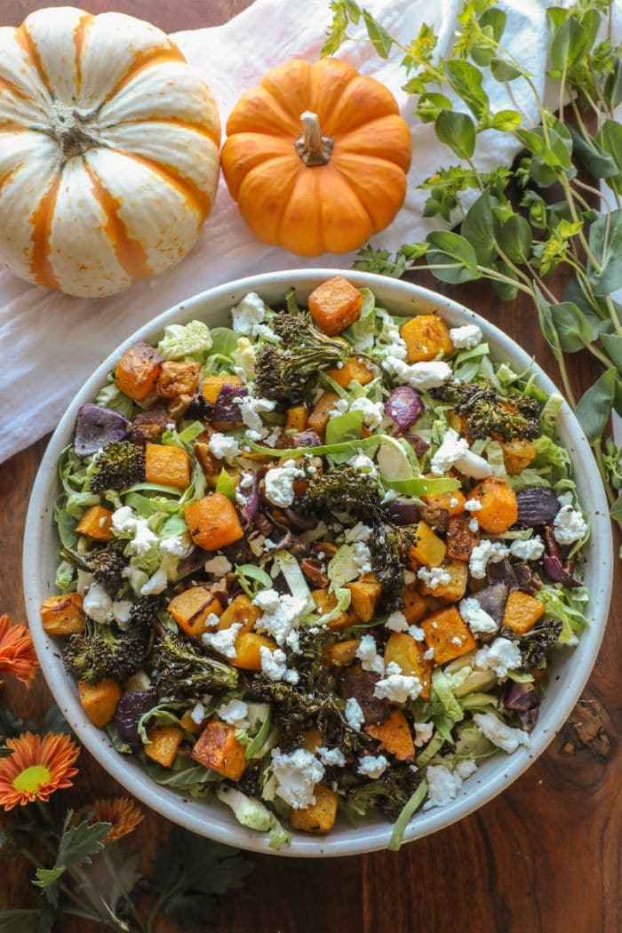 Shredded Brussel Sprouts and Roasted Vegetable Salad in a large white bowl