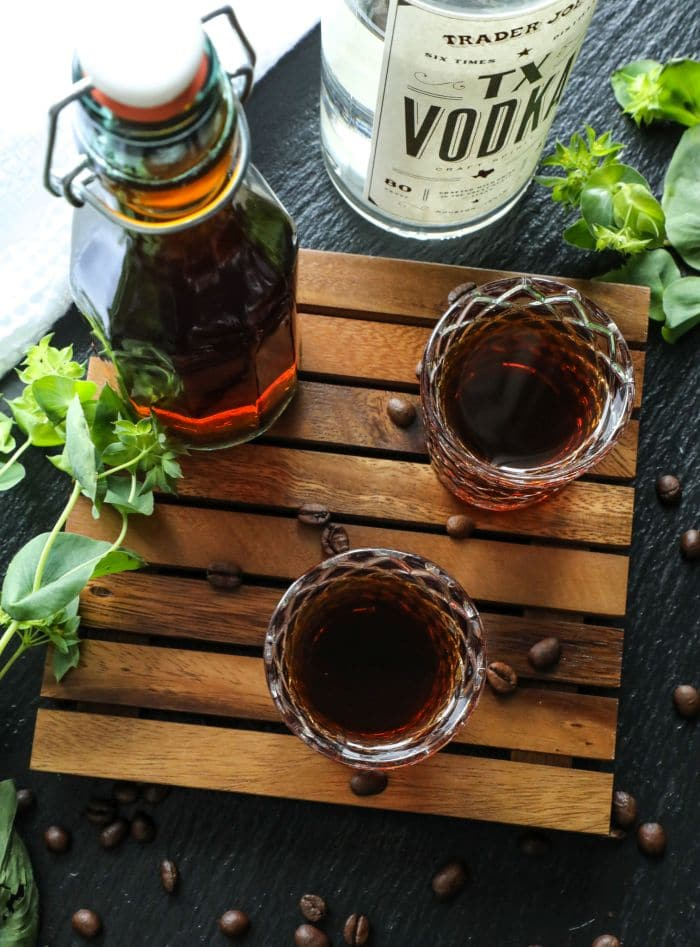 How To Make Homemade Keto Kahlua in two shot glasses on a brown tray