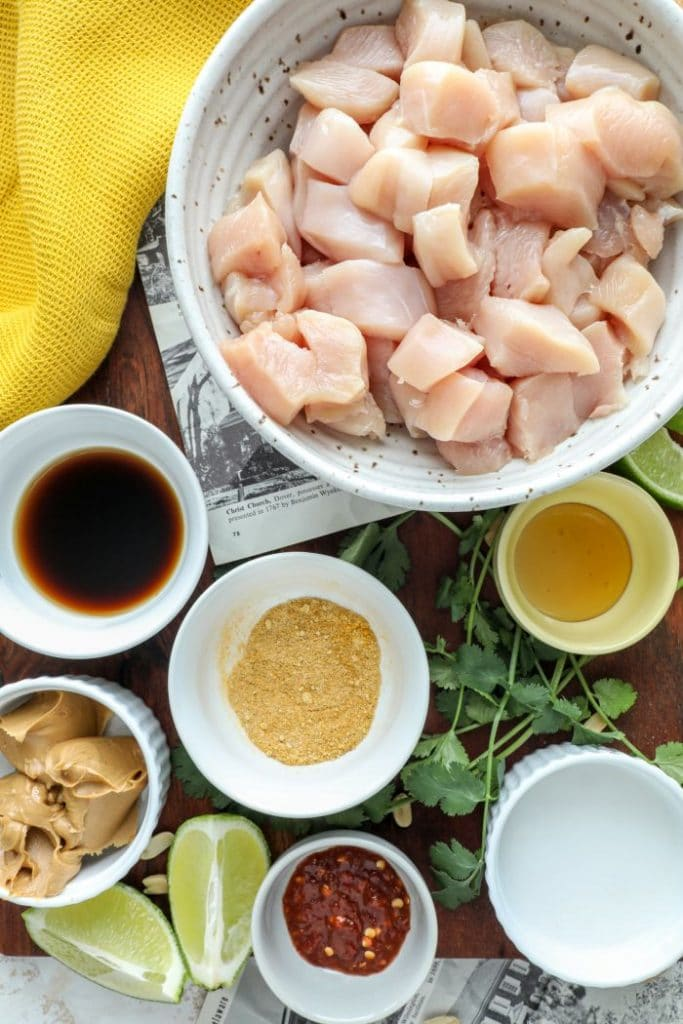 One pan Thai Chicken Satay ingredients on a brown board.
