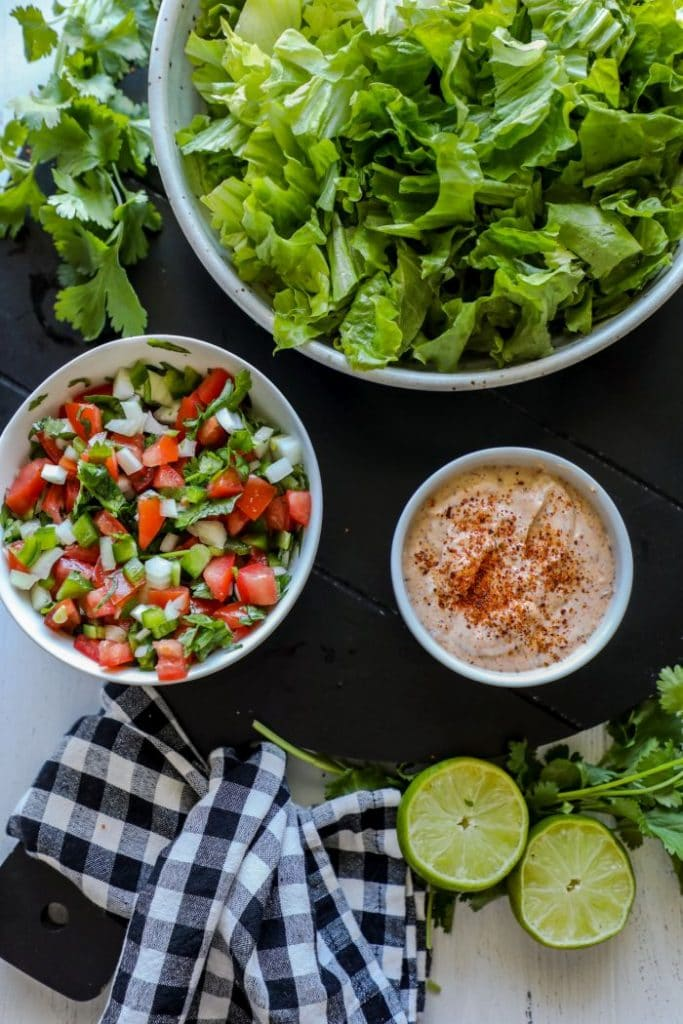 Grilled Chili Lime Chicken Fajita Salad toppings and lettuce.